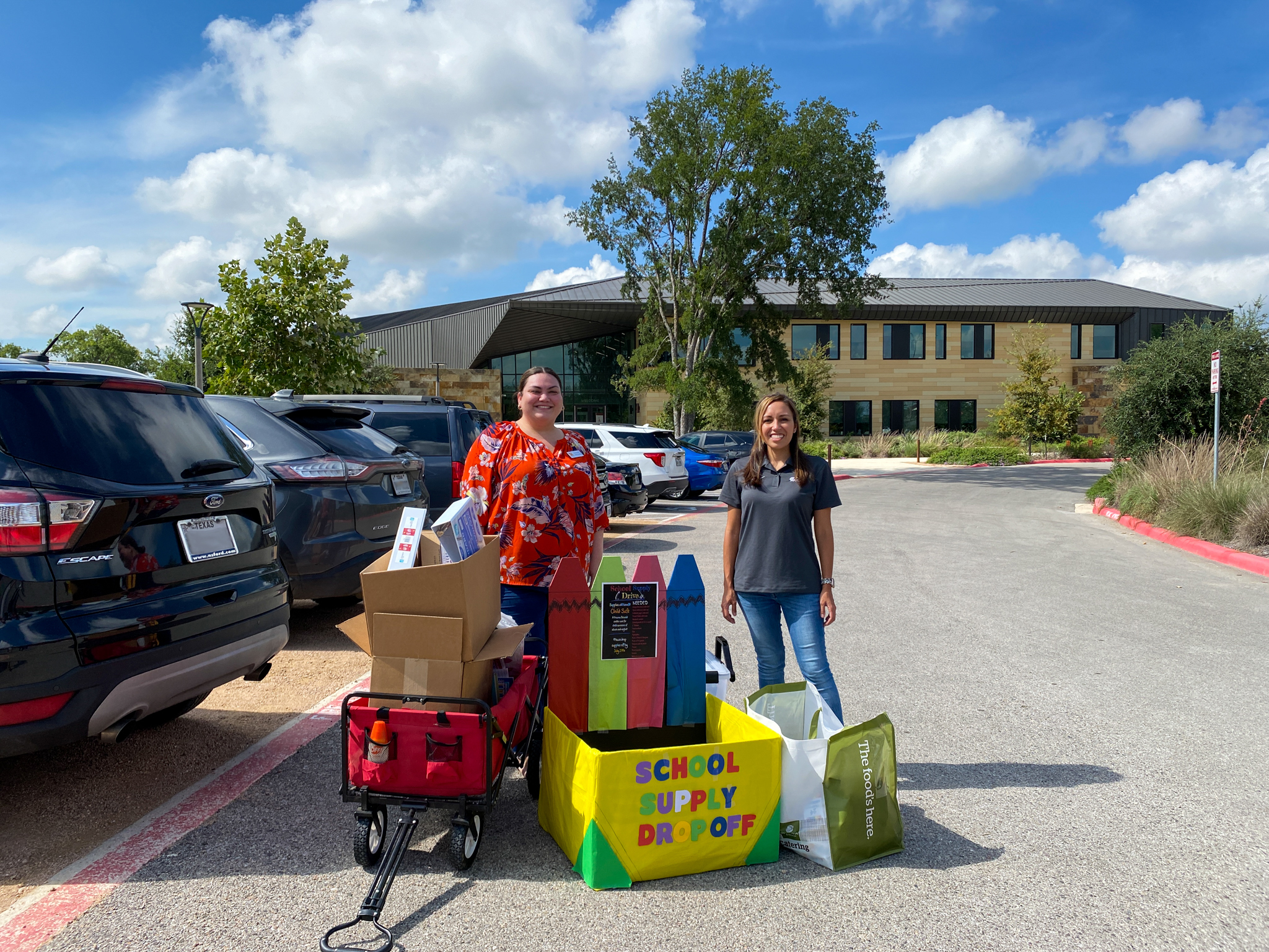 CDS Muery and ChildSafe representatives surrounded by the school supplies donations at ChildSafe.
