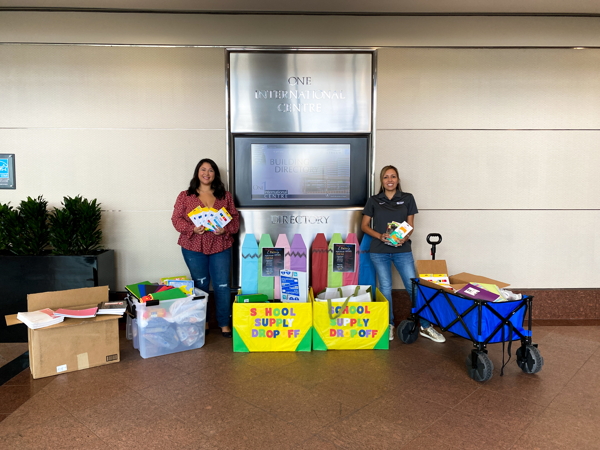 CDS Muery and Stream representatives surrounded by the school supplies donations in the lobby.